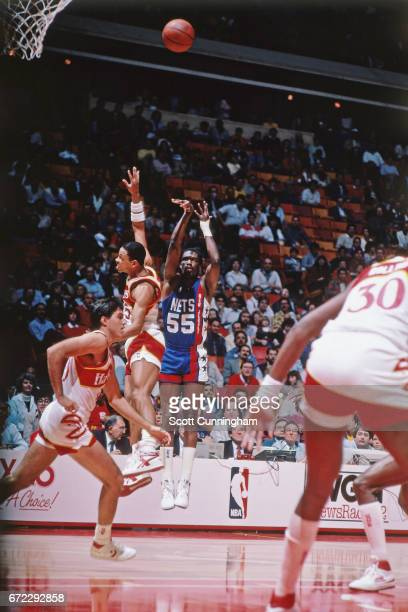 Albert King of the New Jersey Nets shoots against the Atlanta Hawks during a game played circa 1990 at the Omni in Atlanta Georgia NOTE TO USER User...