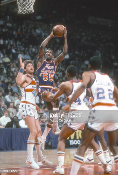 Albert King of the New Jersey Nets shoots against the Washington Bullets during an NBA basketball game circa 1983 at the Capital Centre in Landover...