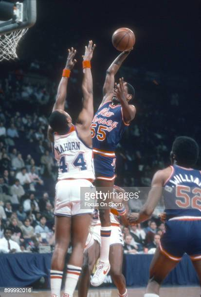 Albert King of the New Jersey Nets shoots over Rick Mahorn of the Washington Bullets during an NBA basketball game circa 1983 at the Capital Centre...