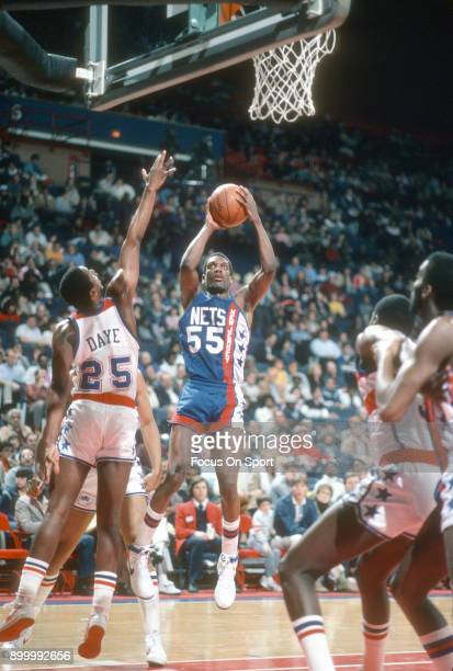 Albert King of the New Jersey Nets shoots the ball against the Washington Bullets during an NBA basketball game circa 1985 at the Capital Centre in...