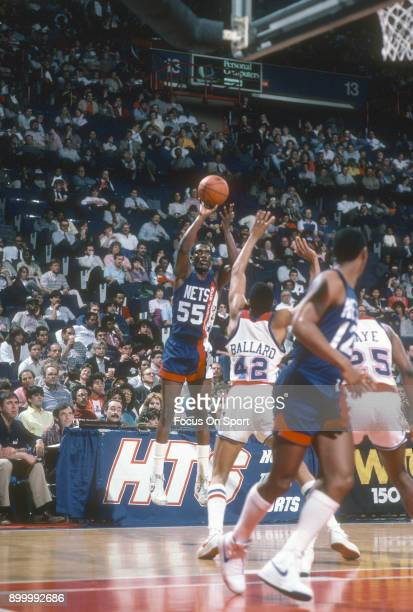 Albert King of the New Jersey Nets shoots the ball against the Washington Bullets during an NBA basketball game circa 1984 at the Capital Centre in...