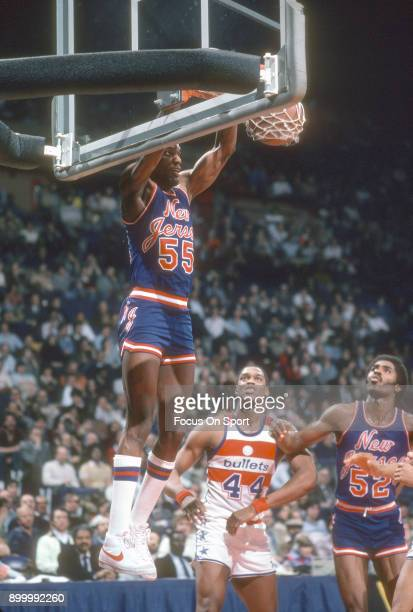Albert King of the New Jersey Nets slam dunks the ball against the Washington Bullets during an NBA basketball game circa 1983 at the Capital Centre...