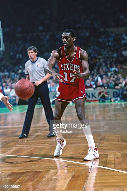Albert King of the Philadelphia 76ers passes the ball against the Boston Celtics during a game played in 1988 at the Boston Garden in Boston...