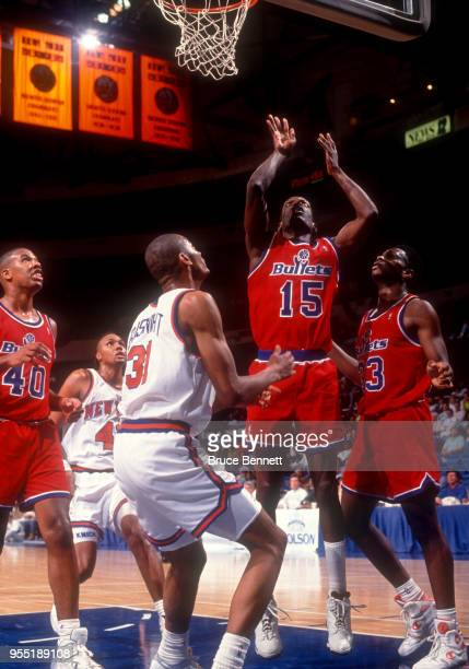Albert King of the Washignton Bullets shoots during an NBA preseason game against the New York Knicks circa October 1991 at the Nassau Coliseum in...