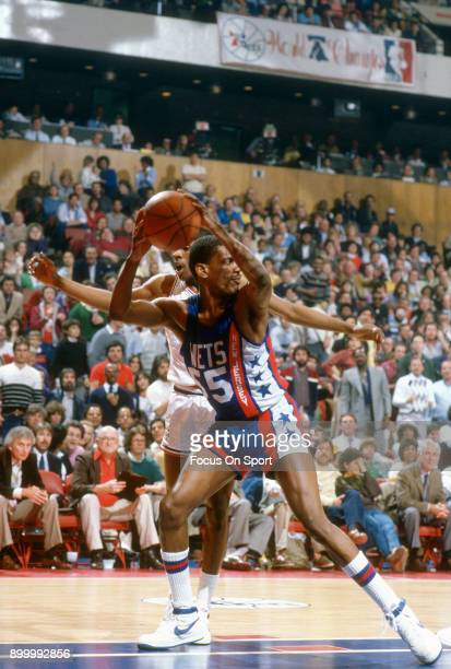 Albert Kings of the New Jersey Nets in action against the Philadelphia 76ers during an NBA basketball game circa 1984 at The Spectrum in Philadelphia...