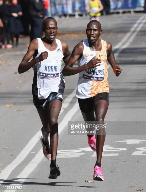 Albert Korir of Kenya and Geoffrey Kamworor of Kenya run through Central Park before finishing first for the Pro Mens in the TCS New York City...