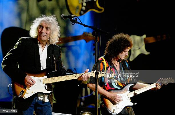 Albert Lee of The Crickets and Brian May of Queen performs on stage during rehearsal as part of 'The Miller Strat Pack' concert at Wembley Arena on...
