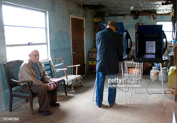 Albert Lewis left waits as Stan Sarvis votes in the South Carolina Republican presidential primary at the Jernigan's Crossroads precinct in Horry...