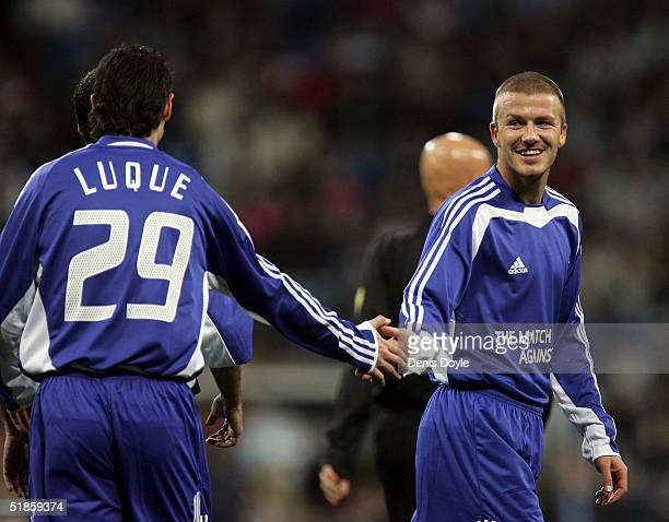 Albert Luque is congratulated by David Beckham after scoring a goal during a United Nations soccer Match Against Poverty on December 14 2004 at the...