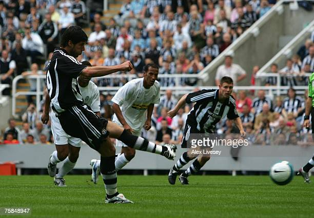 Albert Luque of Newcastle United scores the opening goal from the penalty spot during a preseason friendly between Newcastle United and Juventus at...