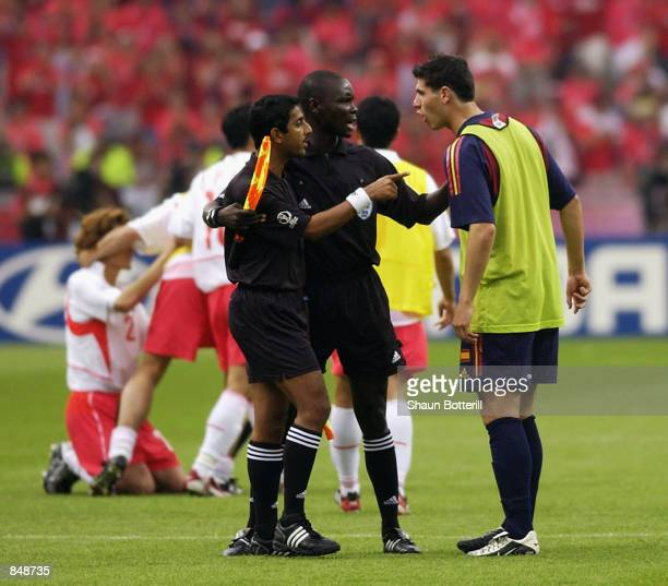 Albert Luque of Spain argues with Assistant Referees Ali Tomusange and Michael Ragoonath after the FIFA World Cup Finals 2002 Quarter Finals match...