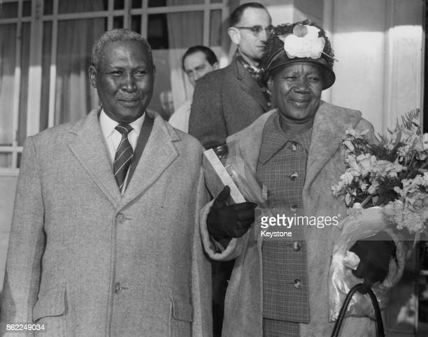 Albert Luthuli and his wife Nokukhanya leave the Dorchester Hotel in London for the airport 7th December 1961 They are passing through London en...