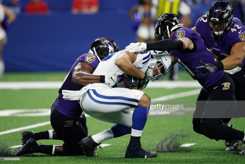 Albert McClellan #50 and Kai Nacua #31 of the Baltimore Ravens make a tackle against Ross Travis #43 of the Indianapolis Colts in the third quarter of a preseason game at Lucas Oil Stadium on August 20, 2018 in Indianapolis, Indiana.