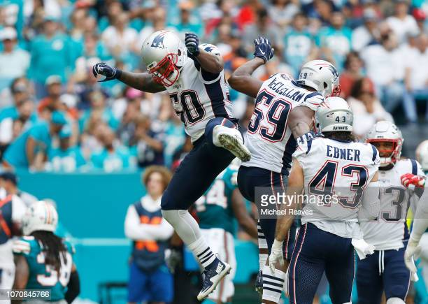 Albert McClellan and Ramon Humber of the New England Patriots celebrate after blocking the punt during the second quarter against the Miami Dolphins...