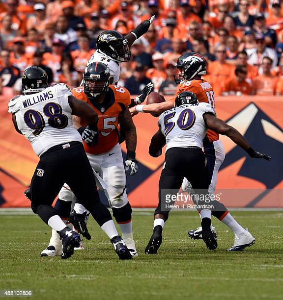 Albert McClellan of the Baltimore Ravens comes in to sack Peyton Manning of the Denver Broncos for a loss of 9 yards during the second quarter The...
