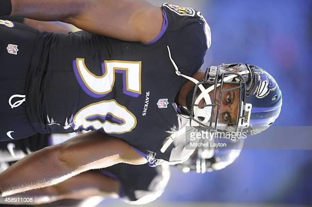 Albert McClellan of the Baltimore Ravens looks on before a NFL football game against the Atlanta Falcons at MT Bank Stadium on October 19 2014 in...