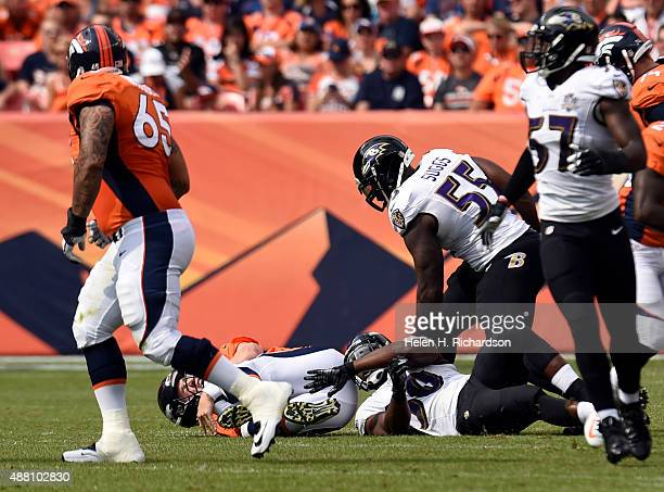 Albert McClellan of the Baltimore Ravens sacks Peyton Manning of the Denver Broncos for a loss of 9 yards during the second quarter The Denver...