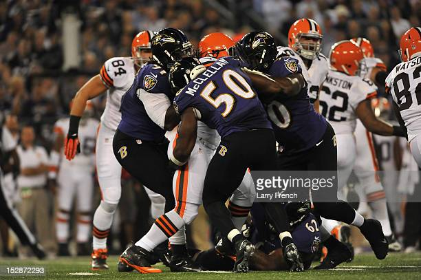 Albert McClellan of the Baltimore Ravens tackles Trent Richardson of the Cleveland Browns with the help of his teammates at MT Bank Stadium on...