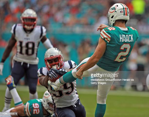 Albert McClellan of the New England Patriots blocks Matt Haack of the Miami Dolphins punt during the first half of the NFL game at Hard Rock Stadium...