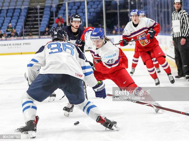 Albert Michnac of Czech Republic skates against Kasper Kotkansalo of Finland during the third period of play in the IIHF World Junior Championships...