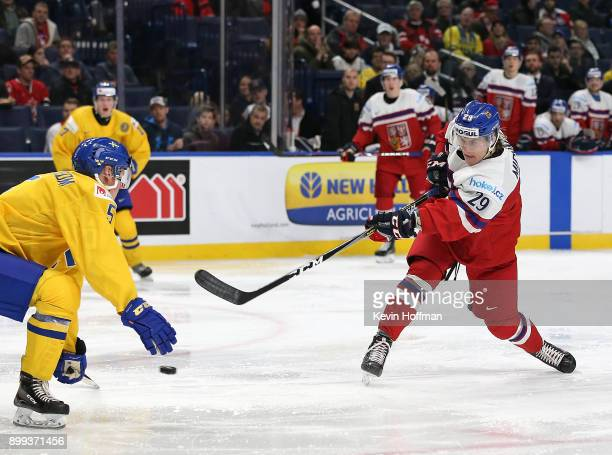 Albert Michnac or Czech Republic takes a shot as Gustav Lindstrom of Sweden defends in the second period during the IIHF World Junior Championship at...