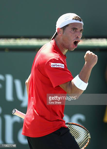 Albert Montanes of Spain celebrates winning a point during his match against Jarkko Nieminen of Finland during the BNP Paribas Open at the Indian...