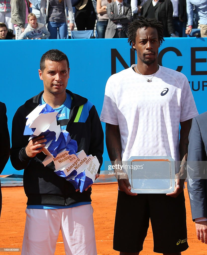 Albert Montanes of Spain holding the trophy and Gael Monfils of France after their final match during day seven of the Open de Nice Cote d'Azur 2013 at the Nice Lawn Tennis Club on May 25, 2013 in Nice, France.