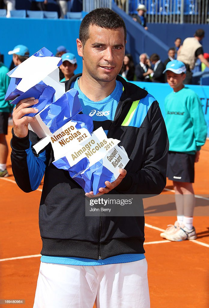 Albert Montanes of Spain holds the trophy after beating Gael Monfils of France in their final match during day seven of the Open de Nice Cote d'Azur 2013 at the Nice Lawn Tennis Club on May 25, 2013 in Nice, France.