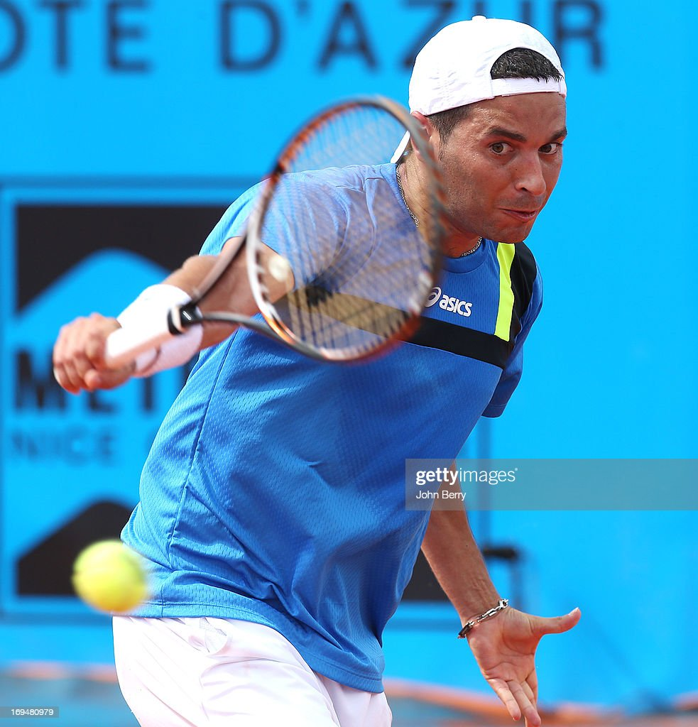 Albert Montanes of Spain in action against Gael Monfils of France in their final match during day seven of the Open de Nice Cote d'Azur 2013 at the Nice Lawn Tennis Club on May 25, 2013 in Nice, France.