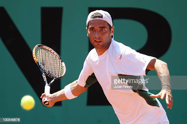 Albert Montanes of Spain plays a forehand during the mens singles first round match between Albert Montanes of Spain and Stefano Galvani of Italy...