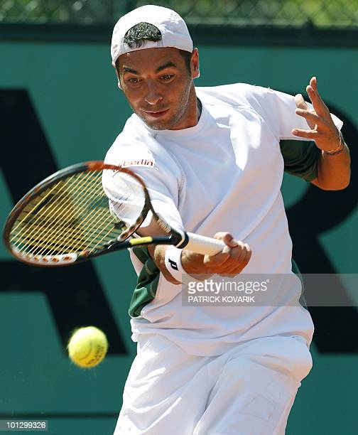 Albert Montanes of Spain plays a return to Stefano Galvani of Italy during their men's first round match at the French Open tennis championship at...