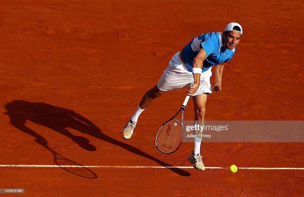Albert Montanes of Spain serves to Milos Raonic of Canada during day two of the ATP Monte Carlo Masters on April 16, 2012 in Monte-Carlo, Monaco.