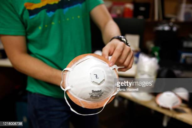 Albert Nazeeri demonstrates his experiment to disinfect respirator masks inside his lab at the California Institute of Technology in Pasadena on...