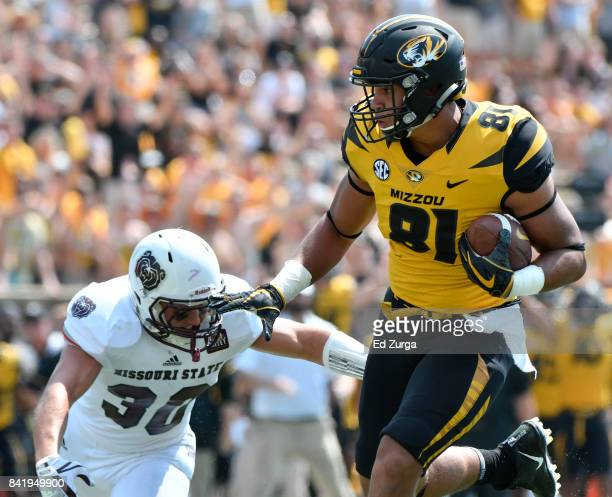 Albert Okwuegbunam of the Missouri Tigers gets past Jared Beshore of the Missouri State Bears as he scores in the third quarter at Memorial Stadium...
