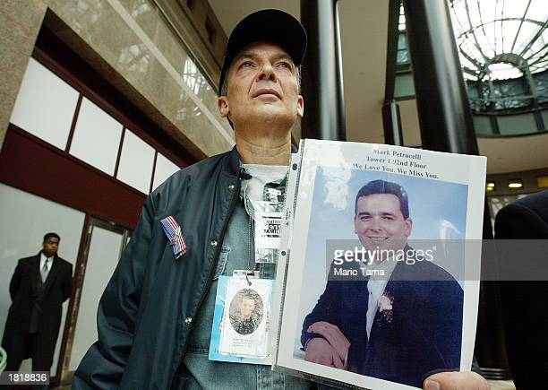 Albert Petrocelli holds a photo of his son Mark as he attends a media conference announcing the winning design for the World Trade Center site...