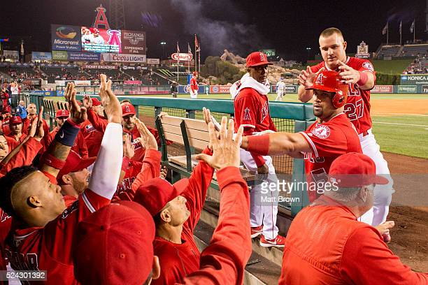 Albert Pujols and Mike Trout of the Los Angeles Angels of Anaheim celebrate with teammates after Pujols hit a solo home run during the third inning...