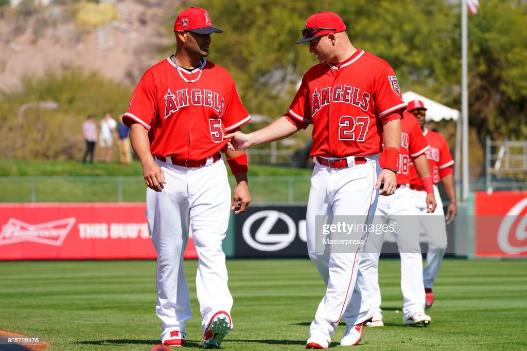 Albert Pujols #5(L) and Mike Trout #27(R) of the Los Angeles Angels talks prior to the game between Cleveland Indians and Los Angeles Angels on February 28, 2018 in Tempe, Arizona.