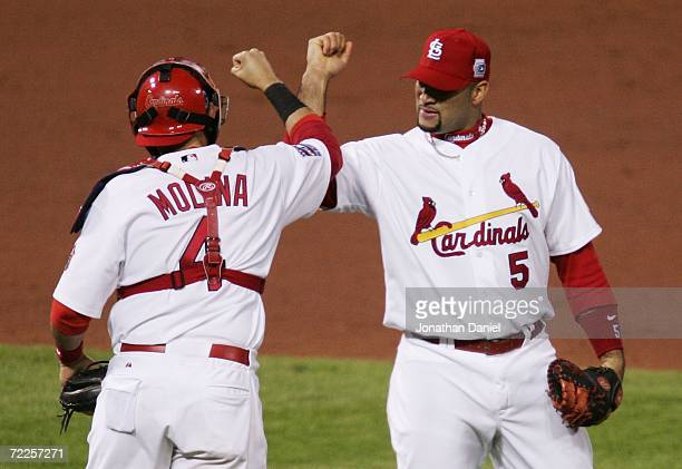 Albert Pujols and Yadier Molina of the St. Louis Cardinals celebrate after defeating the Detroit Tigers to take Game Three of the 2006 World Series...