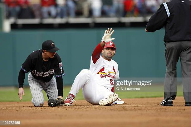 Albert Pujols asks for time after hitting a firstinning double during action between the Arizona Diamondbacks and St Louis Cardinals at Busch Stadium...