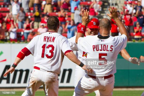 Albert Pujols, Brendan Ryan, Matt Holliday all of the St. Louis Cardinals celibrate Holliday's walk-off RBI single against the Los Angeles Dodgers at...