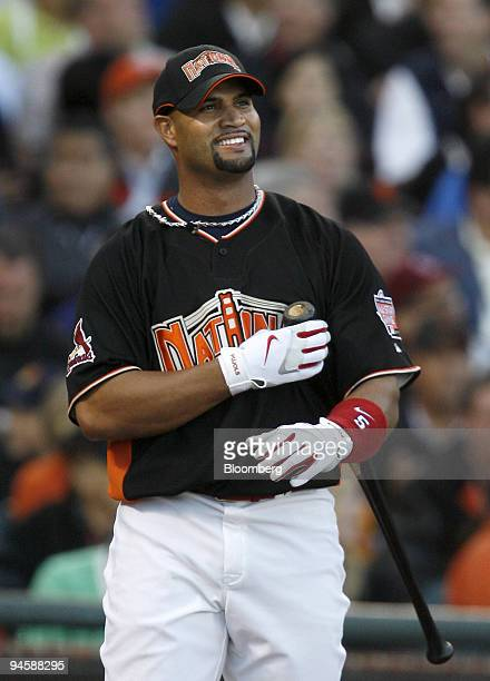 Albert Pujols of Major League Baseball's St Louis Cardinals watches the ball after hitting in the second round of the home run derby at the AllStar...