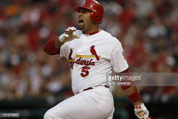 Albert Pujols of the Cardinals reacts as he fouls a ball off his calf during action between the New York Mets and the St Louis Cardinals at Busch...