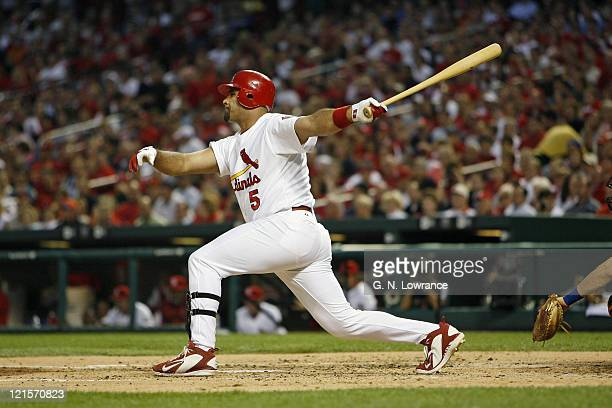 Albert Pujols of the Cardinals takes a swing during action between the New York Mets and the St Louis Cardinals at Busch Stadium in St Louis Missouri...