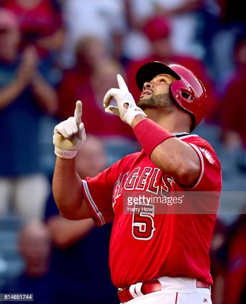 Albert Pujols of the Los Angeles Angels celebrates his solo homerun to tie the score 11 with the Tampa Bay Rays during the second inning at Angel...