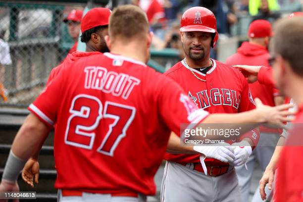 Albert Pujols of the Los Angeles Angels celebrates his third inning solo home run to reach 2000 career RBI's with Mike Trout while playing the...
