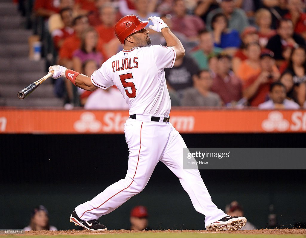 Albert Pujols #5 of the Los Angeles Angels hits a bloop single to score two runs for a 3-1 lead over the Chicago White Sox during the third inning at Angel Stadium of Anaheim on September 21, 2012 in Anaheim, California.