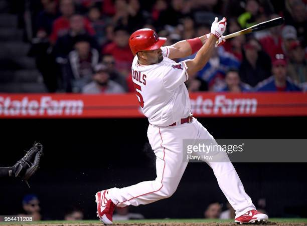 Albert Pujols of the Los Angeles Angels hits a double for his 2999th career hit during the second inning against the Baltimore Orioles at Angel...