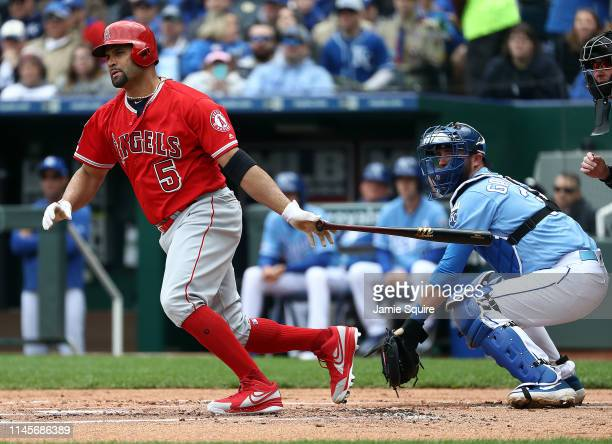 Albert Pujols of the Los Angeles Angels hits a double to knock in two runs during the 1st inning of the game against the Kansas City Royals at...