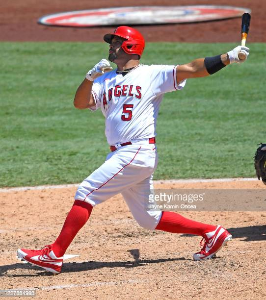 Albert Pujols of the Los Angeles Angels hits a grand slam home run in the third inning of the game against the Houston Astros at Angel Stadium of...