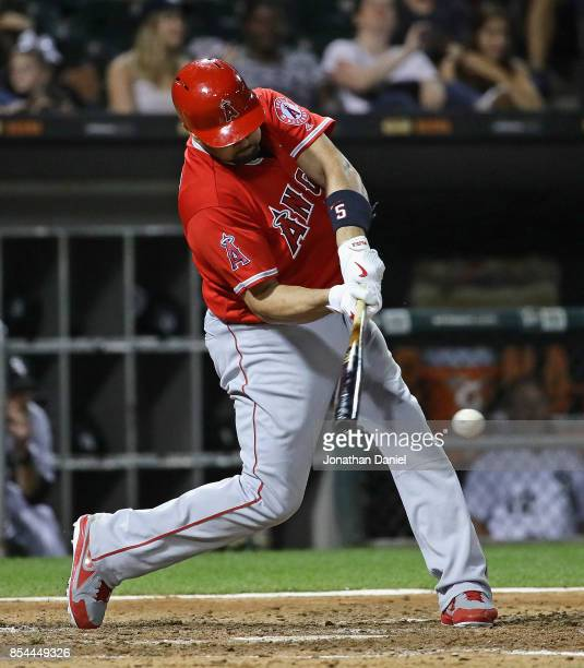 Albert Pujols of the Los Angeles Angels hits a two run single giving him his 99nd and 100th RBI for the season in the 7th inning against the Chicago...